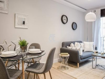 Photo for HOMES IN BLUE - Spectacular apartment decorated with a fresh and natural style. 1 bedroom and 1 bathroom. Kitchen fully equiped. Located in the Eixample.