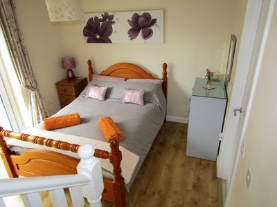 Lovely downstairs bedroom with double patio doors and under floor heating