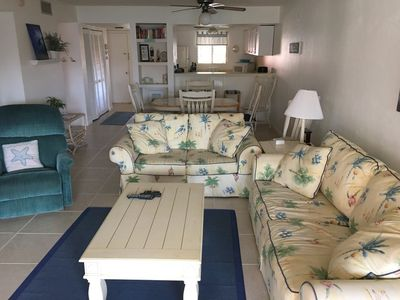 Photo for 2 BEDROOM 2 BATH PET FRIENDLY CONDO WITH POND VIEW AND EASY ACCESS TO THE BEACH.  APRIL OPENING FROM 4/11 to 4/25  $1600.00/WEEK PLUS FEES.