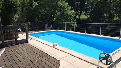 Photo for Cottage with pool bordering waterfalls