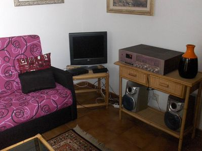 Living room. ASTRA satellite TV. and stereo MARANTZ