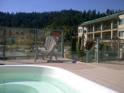 Photo for Peaceful Waterfront Penthouse with private dock, pool and hot tub