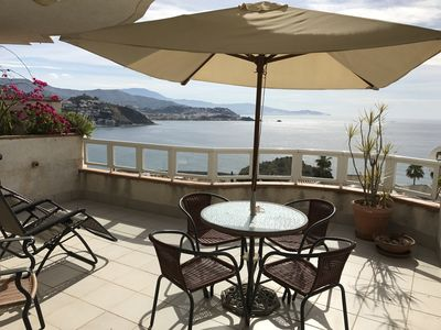 Photo for Luxury 3 bed 2 bath apartment with stunning sea views private walled garden and shared pool