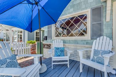 front patio enclosed with white picket fence