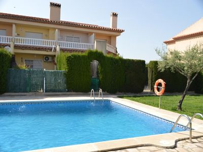 Photo for HOUSE WITH BARBECUE, INTERNET, WIFI, GARDEN, AIR CONDITIONING AND POOL Comunit