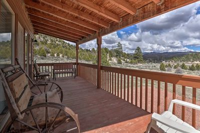 Large front porch with plenty of seats to enjoy the sunrise or wildlife viewing.