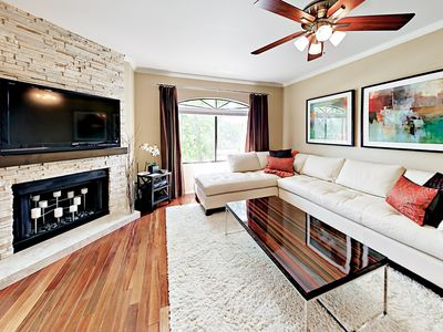 Living Room - Gather around the flat screen TV for a movie night. (Please note the fireplace is not operational)