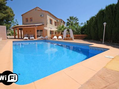 Photo for 5 bedroom Villa, sleeps 11 with Pool, Air Con, WiFi and Walk to Beach & Shops