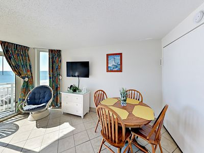 Dining Area - Gather for home-cooked meals at the 4-person dining table.