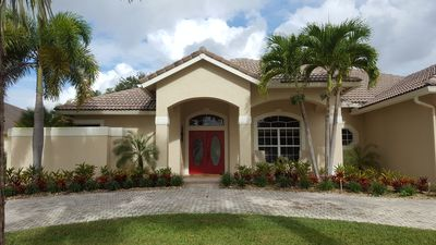 Photo for Relaxing retreat in gated marine community. 4/3 pool home  Minimum 90 night stay