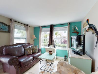 Photo for Cozy bayfront cottage with free WiFi near beaches and more