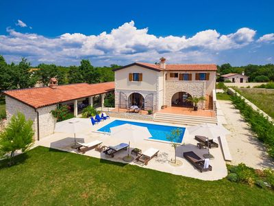 Photo for This 4-bedroom villa for up to 6 guests is located in Vodnjan and has a private swimming pool, air-c