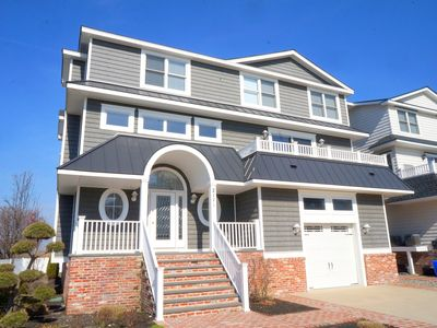Photo for SLEEPS 16!!! Huge Single Family Home located on the south end of Sea Isle City. Huge deck with incredible views of the wetlands!