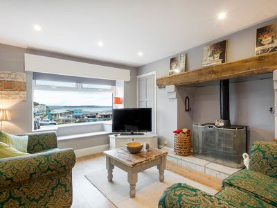 Photo for Front Row Cottage Brixham - a harbourside cottage with spectacular sea views