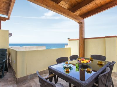 Photo for Alghero Center - Large penthouse with sea view on two floors for 12 people