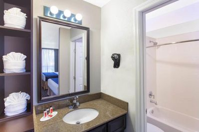 Bathroom with a shower and tub. The essential kit and towels are provided!