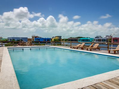 Photo for Beachfront apartment with water views, shared pool, convenient location!