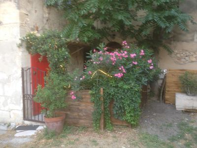 Photo for Charming full center of the village of Maussane Les Alpilles with patio