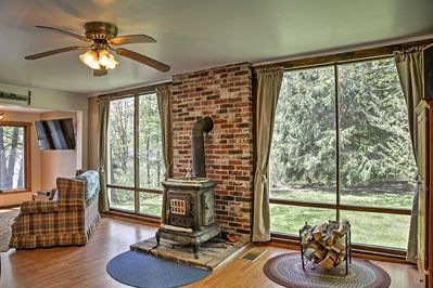 Natural light flooding from floor-to-ceiling windows welcome you inside.