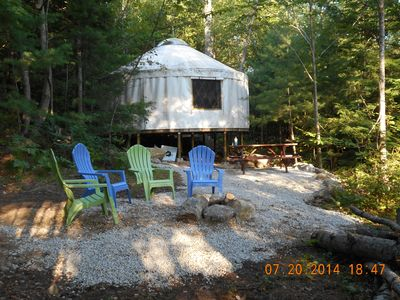 The back of our yurt with the cozy fire pit area