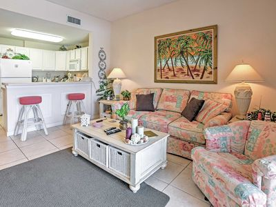 Take a seat in the living room which features a couch and armchair and unwind after a long day of traveling.
