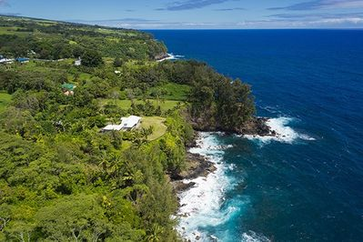 The picturesque Hamakua coast with the house pictured on the left.