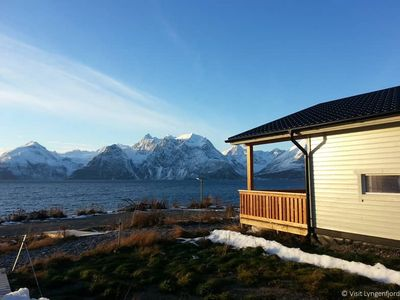 Photo for Holiday house with breathtaking panoramic view of the mountains, directly by the fjord