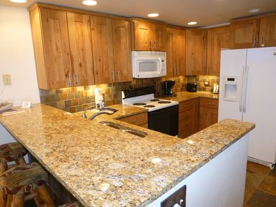 Beautifully remodeled kitchen with alder wood cabinets and granite counter tops.