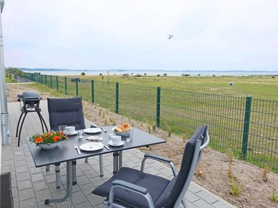 Photo for Apartment near the beach with fireplace & water views in the Baltic Sea resort Olpenitz