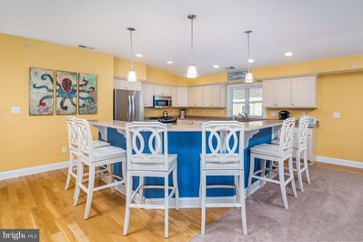 Top floor fully-equipped Chef's kitchen w gas cooktop and island that seats six