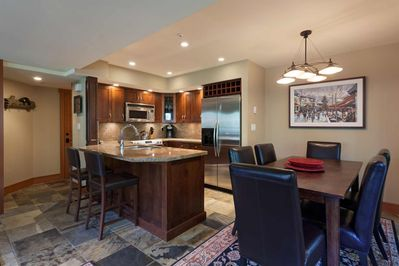 Open concept kitchen, breakfast bar and dining for 6
