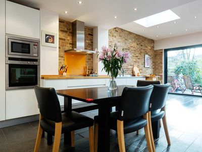 Photo for Vibrantly colourful 4 bedroom home in bustling West London (Veeve)