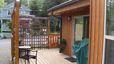 Side deck looking across street, kitchen/dining access, privacy screen, BBQ