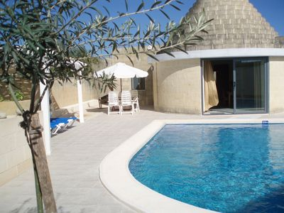 large private swimming pool and sundeck area
