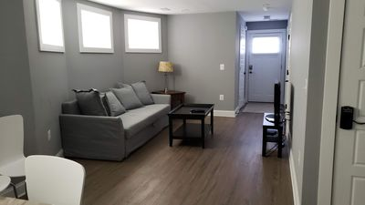 Living room with cable tv; private front entrance