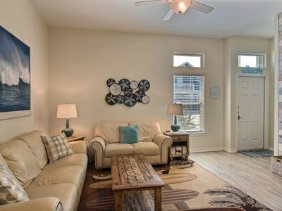 Photo for NEW LISTING! Snowbird-friendly townhome across from beach w/shared pool-dogs OK