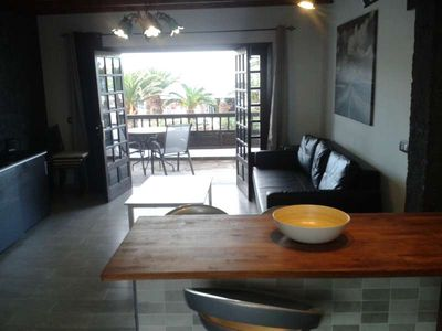 Photo for Apartment KOSTANEW in Costa Teguise for 4 persons with shared pool, terrace, garden, balcony, views to the ocean, views of the volcanoes, WIFI and less than 200m to the sea