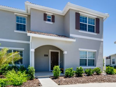 Photo for Amazing 5 Bedroom 4  Bathroom Storey Lake Townhome  Only 8 Minutes To Disney