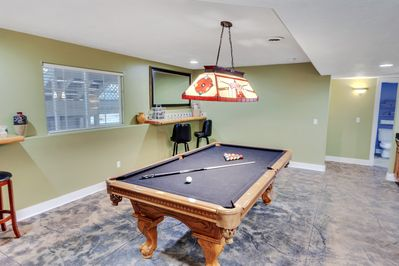 Rec room in the lower level is great for friendly competition or to socialize