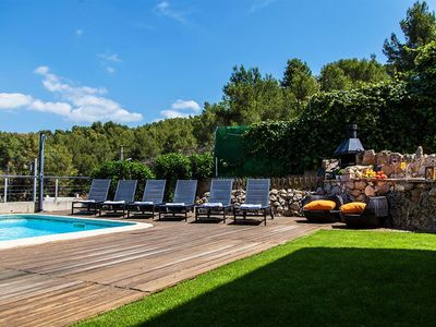 Sitges Villas : pool area with longchairs.