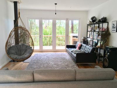 Lounge has 2 three seater couches and a hanging chair