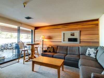 Photo for Ski-in / ski-out condo featuring private hot tub as well as a deck with grill