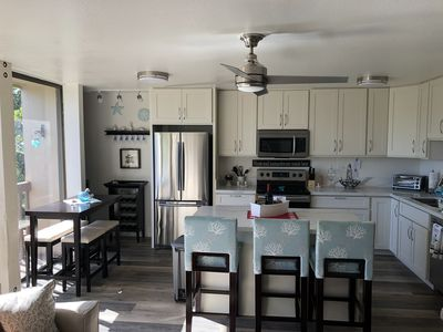 Photo for *Family Getaway* AC on each room/ WiFi/Cable/Free Parking/Pool/24hr Security