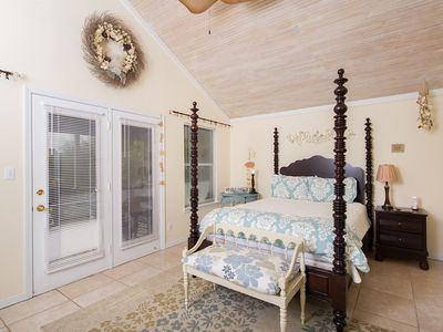 Beautiful upstairs master suite with queen bed, access to private screen porch