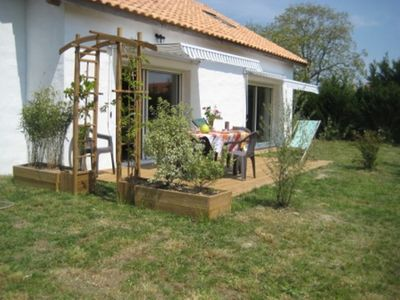 Photo for Cottage in garden with south facing terrace 400 meters from the beaches.