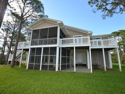 Photo for THIS LOVELY BAYFRONT home is in a very private wooded area that is great for the outdoors family.