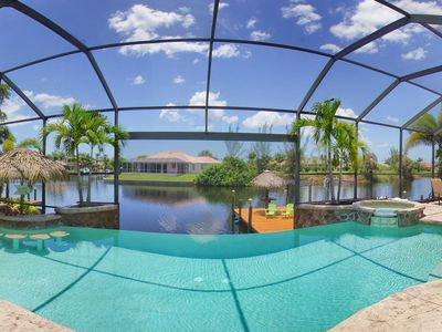 Photo for Luxury waterfront villa with stunning pool and Tiki hut!