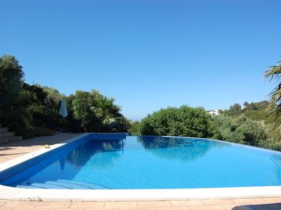 Photo for Villa with large infinity pool, gardens and parking for 2 cars, with sea views