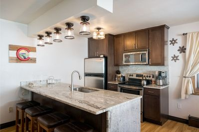 Granite counters & back-splash, new cabinets & stainless steel appliances