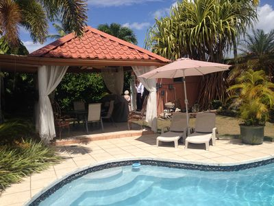 Photo for Tropical Home with Pool, A/C and 3 blocks to beach, Gated Security
